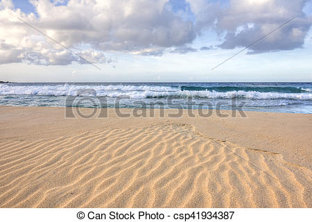 Pictures of Ripples in sand on tropical beach.