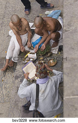 Pictures of A Hindu funeral ceremony at a temple in Kathmandu.