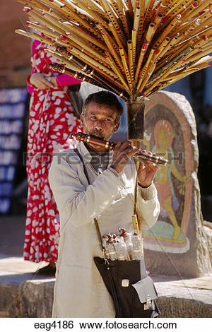 Stock Images of BAMBOO FLUTE SELLER.