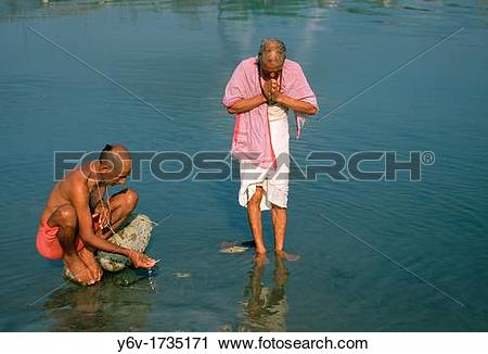 Stock Photography of High caste hindu men performing a ritual in a.