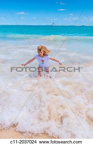 Stock Photo of young girl on beach, Riu Palace, hotel, Punta Cana.
