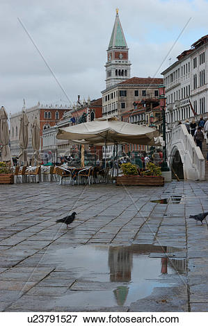 Picture of Riva Schiavoni after rain with reflection of Campanile.