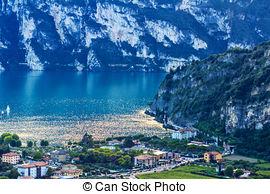 Stock Photography of swan family. Garda lake landscape, Italy.