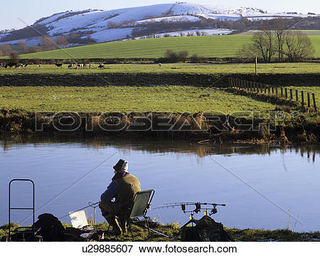 Picture of England, West Sussex, Bury, An angler sat on a seat.