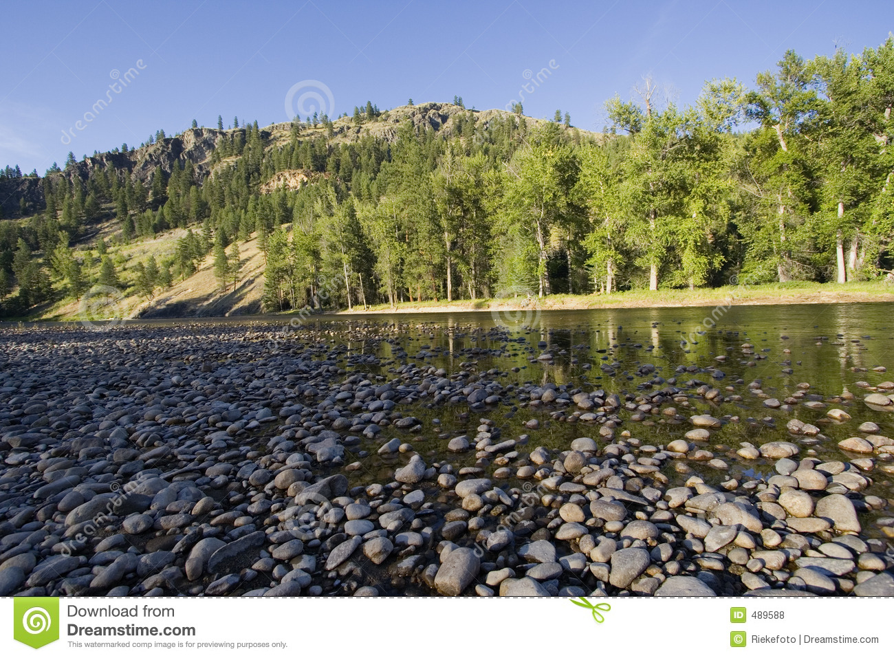 Riverbed With Pebbles In The Evening Sun Royalty Free Stock Photos.