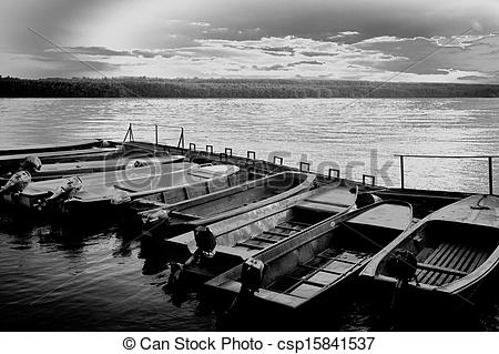 Stock Photos of Wooden boats on a river dock.