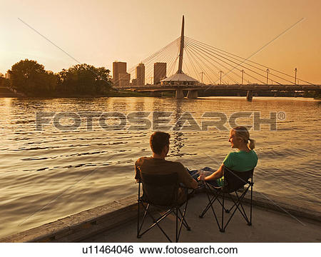 Stock Images of couple on dock along the Red River, Winnipeg.