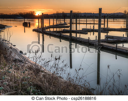 Stock Photography of River Dock at Sunset.