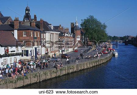 Stock Photo of People on River Embankment York UK uni.