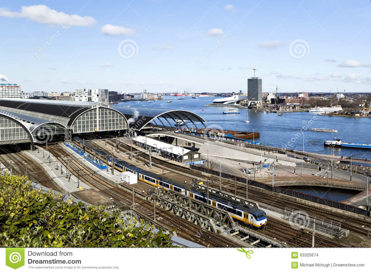IJ River & Railway Station Amsterdam Editorial Stock Image.