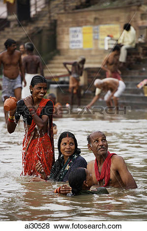 Pictures of People bathing in the Ganges River, Varanasi, India.