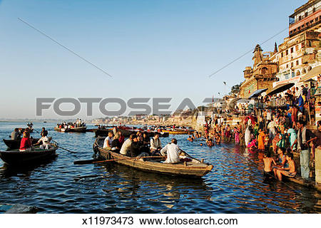 Stock Photo of India, Varanasi, Ganges River, tourist boats by.