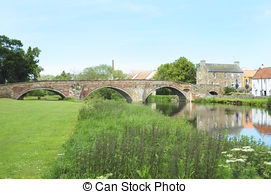 Stock Image of old bridge and river Tyne at Corbridge.