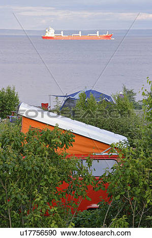 Stock Photography of View of Westfalia and cargo boat on St.