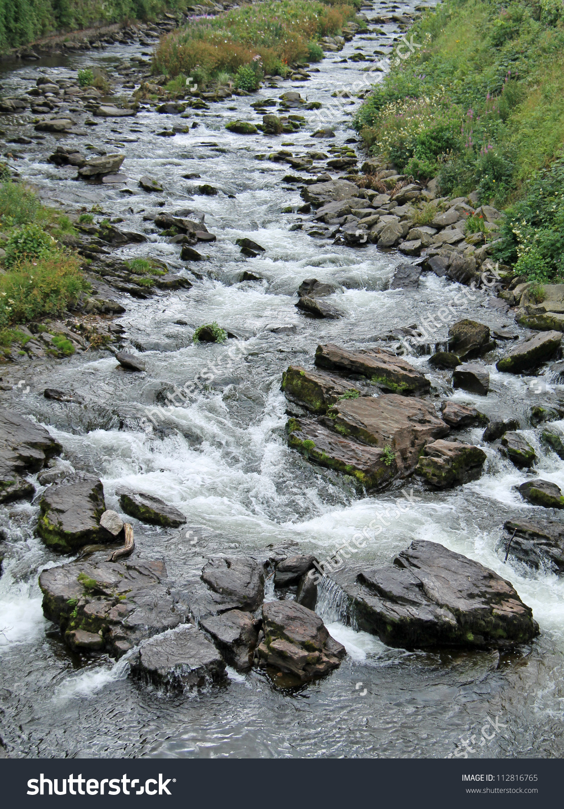Large Stream Running Over Rocky Riverbed Stock Photo 112816765.