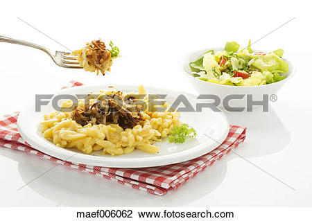 Stock Photo of Plate of spaetzle with cheese and roasted onions.
