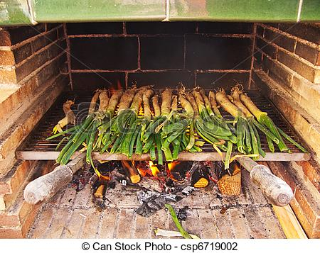 Stock Photo of Calçots, catalan sweet and young onions being.