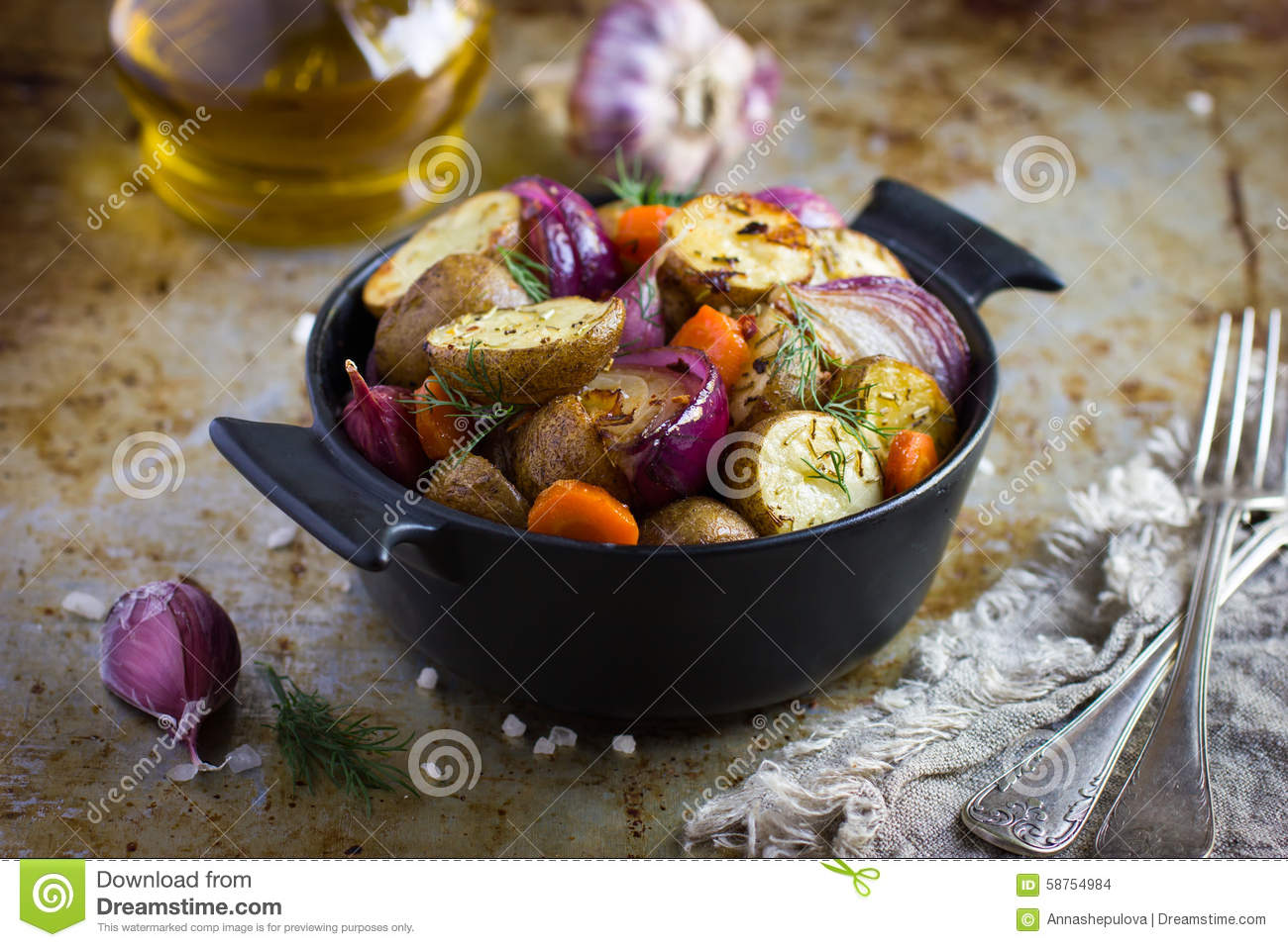 Roasted Potatoes With Onions, Carrot And Garlic Stock Photo.