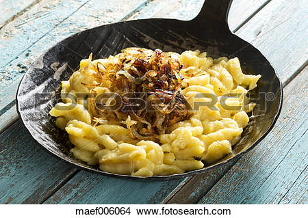 Stock Photo of Spaetzle with cheese and roasted onions in frying.