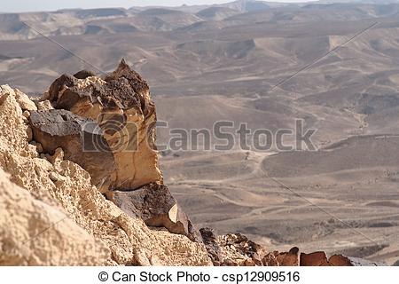 Clipart of Jagged rock on the edge of the cliff in the desert.