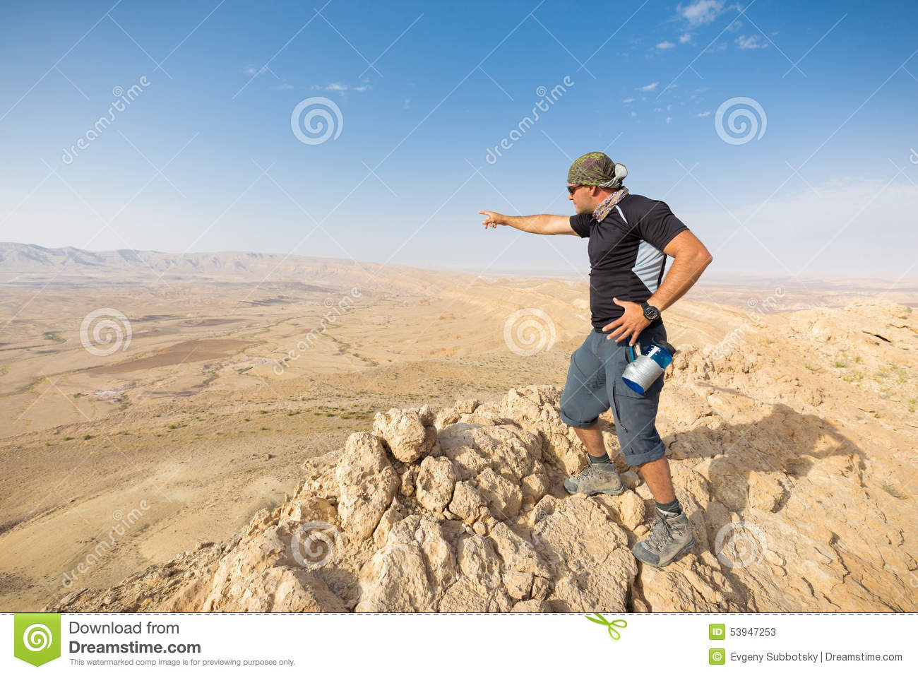 Clip Art Person Standing On the Edge of a Cliff.