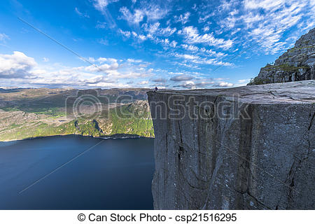 Stock Photographs of Tourist sitting at Famous Pulpit Rock edge in.