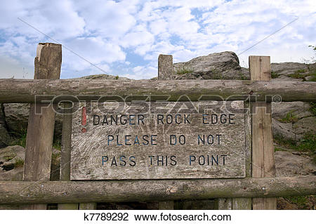 Stock Photo of danger rock edge please do not pass this point sign.