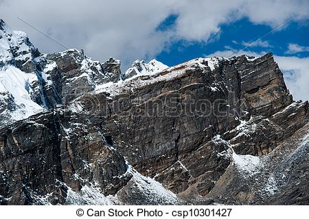 Clip Art of From the top of Gokyo Ri: rocks and snowed cliffs view.