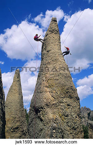 Stock Photo of Two men rapelling from a rock spire in The Needles.
