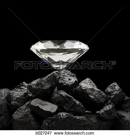 Picture of large diamond on top of a pile of rocks b027247.