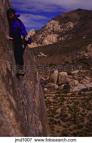 Picture of Rock climber on sheer face, Face Route, Joshua Tree.