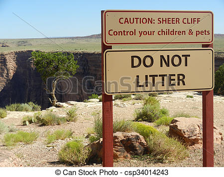 Stock Photo of Caution Sheer Cliff Warning Sign.
