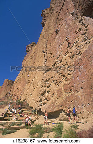 Picture of Rock Climbers Scaling The Sheer Face Of A Cliff.
