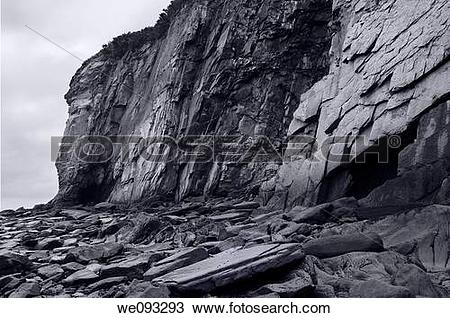 Stock Photo of Black and white image of sheer rock cliff face at.