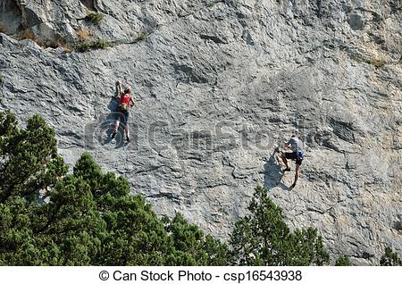 Stock Photos of Climbers on the sheer rock.