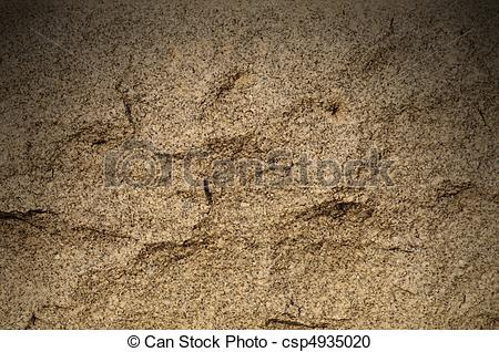 Stock Photography of Granite rock surface lit dramatically from.