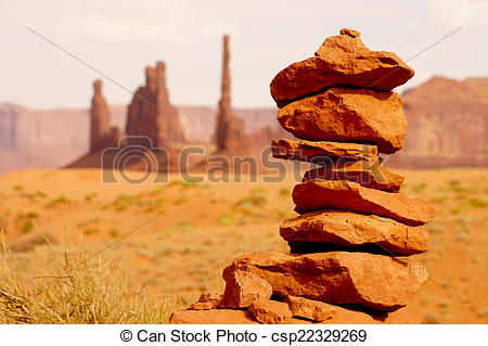 Stock Image of Small rock tower in front of impressive desert.