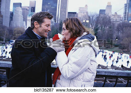 Picture of Couple sharing coffee outside Rockefeller Center, New.