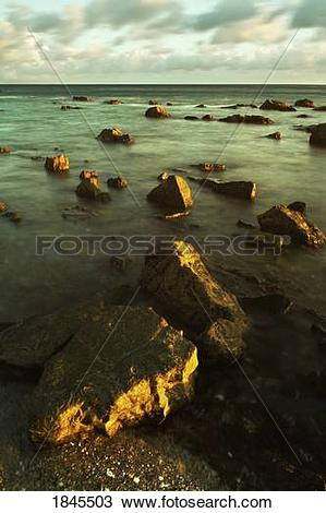 Stock Photo of Rocks in shallow water by the shore 1845503.