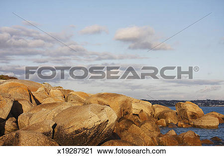 Stock Photography of Rocks and clouds by shore, Beg Meil, Brittany.
