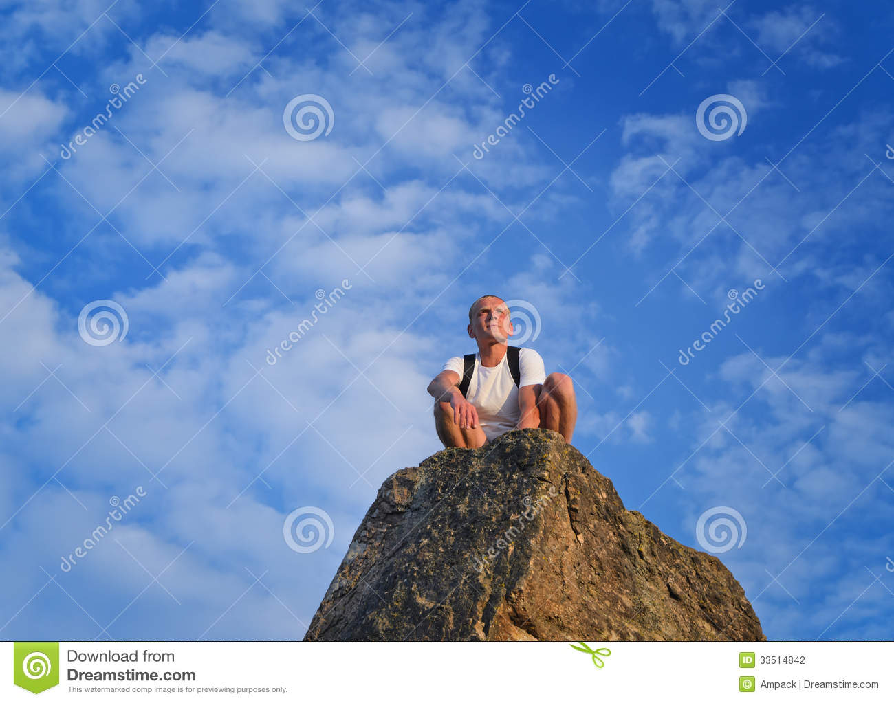 Man Sitting On Top Of A Rocky Pinnacle Stock Photography.