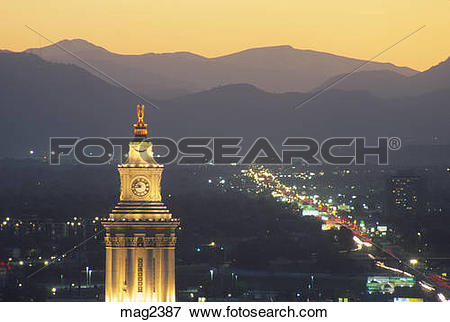 Picture of View of clock tower and distant Rocky Mountains with.