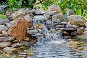Stock Photography of a Backyard Water Fountain With a Rocky.