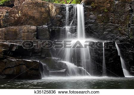 Stock Images of Tropical rocky waterfall k35125836.