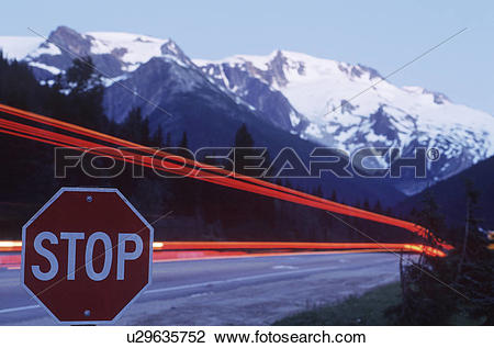 Stock Photo of Rogers Pass, time exposure of highway at stop sign.
