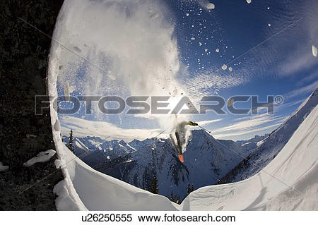 Stock Image of A skier catching air at Rogers Pass, Glacier.