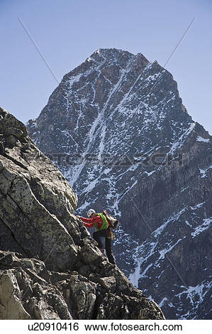 Stock Images of A mountain climber ascends Mt Uto in Roger's Pass.