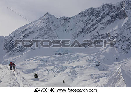 Stock Photography of Two men backcountry skiing, Rogers Pass.