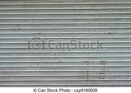 Stock Illustration of Illuminated grunge metallic roll up door.