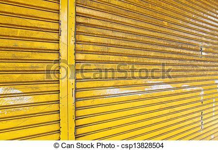Stock Photography of Illuminated grunge metallic roll up door.